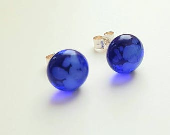 Blue fused glass stud earrings set on a solid Stirling silver post