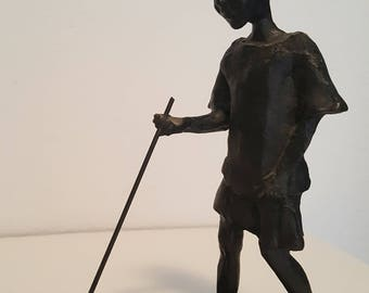bronze statue of corry Abass