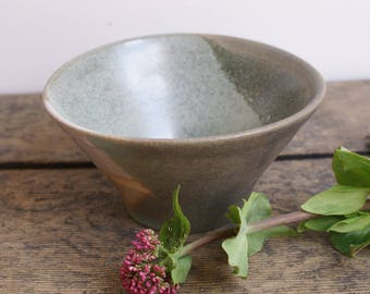 Grey and green serving bowl with raw unglazed areas