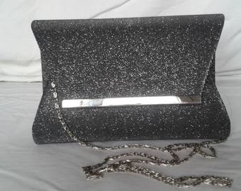 glittery ceremony grey clutches, chain shoulder strap