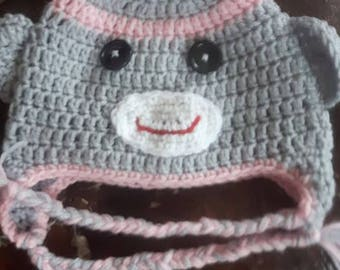 Pink trim monkeu hat