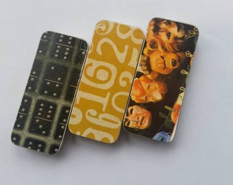 Trio of long thin tins. . . Dominos, mustard numbers, and faces