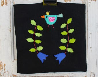 Black linen cushion cover with folk inspired applique
