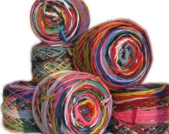 Colorful ball of wool scrap yarn. 3.5 ounces. 200 yards. Self-striping. Magic ball.
