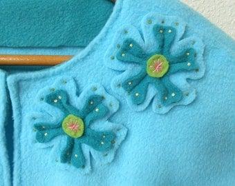 Woman's aqua appliquéd fleece cape, capelet or bed jacket.