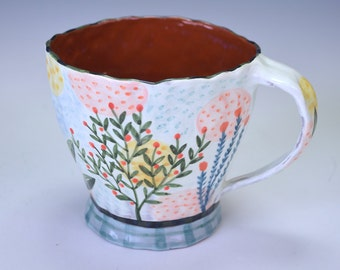 Cup, large pastel, foliage and flowers.