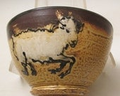Bowl with sheep slip trailed pottery