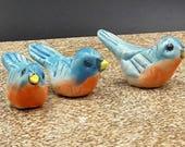three miniature bluebirds -  porcelain sculpture