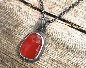 Oxydized sterling silver pendant with freeform orange carnelian faceted cabochon with chain