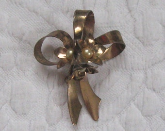 bow brooch . tin bow brooch . bow brooch with pearls
