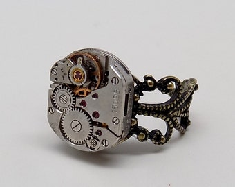 Steampunk jewelry . Steampunk ring with watch mpvement.
