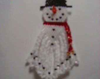 A fun little pair of hand beaded Sammy the Snowman dangle eqarrings with 3d carrot nose