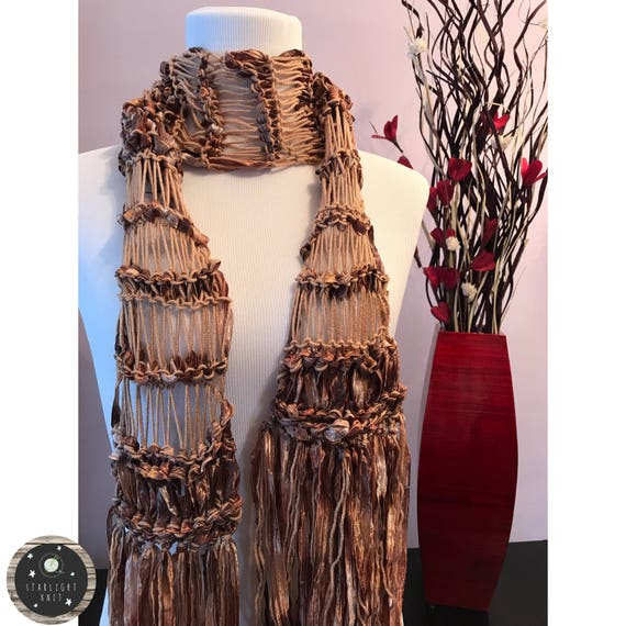 Hand Knit Ladies Fashion Accessory Scarf knit with soft merino wool accented with a beautiful brown shimmer ribbon