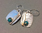 Mixed metal sterling and brass tag necklace with brass streaked turquoise accent, textured sterling earrings with brass accent