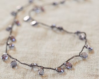 irridescent deep purple drop crocheted necklace on brown strand