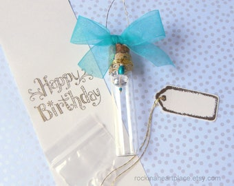 Birthday Card in a Bottle,  message in a bottle, scrolled sentiment, with bead decoration, turquoise bow and gold cord hanger