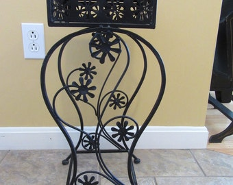 Nice mid century vintage black painted metal plant stand with floral decor- solid, beautiful, ready to use