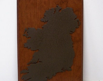 Laser Cutout of Ireland Mounted on Cherry.