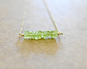tiny peridot heshi bar necklace with gold filled chain.  peridot pendant necklace. apple green bar pendant necklace. peridot jewelry