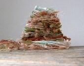 wishing well fiber effects™  art yarn bundle 15yd ribbon embellishment trim mixed fiber earthy sampler pack . blue green chestnut peach