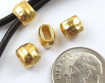 TierraCast Leather Crimp Beads-Gold HAMMERTONE BARREL ID 4X2mm (4)