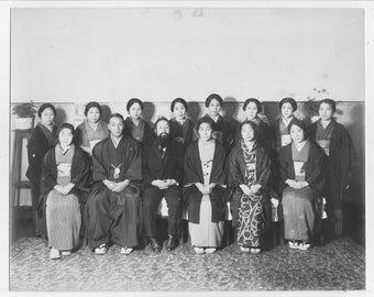 Vintage Japan black and white photo of a group of Japanese  men and women.