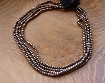 faceted pyrite beads in 'copper'