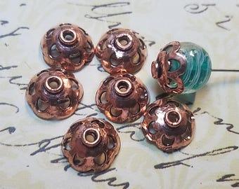 Copper bead caps.