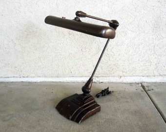 Vintage Art Deco Streamline Desk Lamp with Articulated Arm. Circa 1950's.