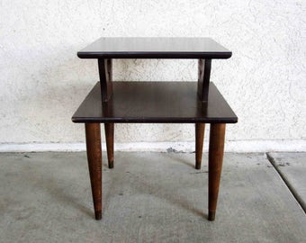 Vintage Mid Century 2 Tier End Table in Dark Walnut Finish. Circa 1950's - 1960's.
