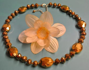 Lovely unusual vintage 1980s adjustable grinded goldcolor glass bead necklace with lobster clasp and knots between the beads