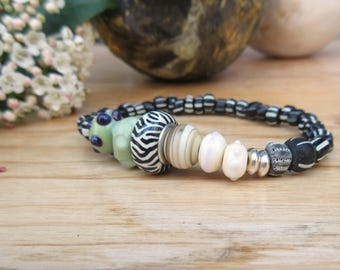 And the river murmured .....: a contemporary bracelet with artisanal lampworks beads  ....