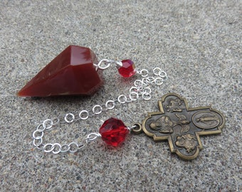 Carnelian Pendulum with a Sterling chain Vintage Brass four way Religious medal and a Vintage Red AB bead