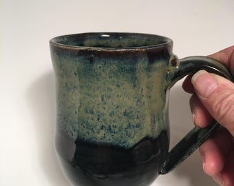 Black with citrus glaze mug cup hand made by Ruth Sachs