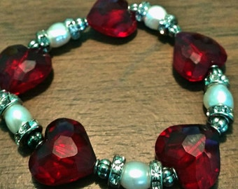 Happy Valentine's Day This stretchy bracelet is a OOAK.  Stunningly beautiful Made with red glass crystal hearts and white glistening pearls