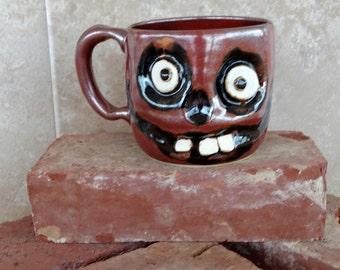 Skeletal Walking Dead Coffee Cup. Creepy Zombie lover. Large Ceramic Mug Scary Face Handmade Pottery Ug Chug. Brick red. Microwave Safe.