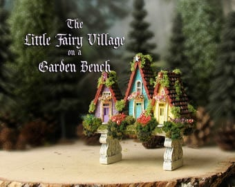 Miniature Fairy Village on a Garden Bench -  Hand-Painted Mini Resin Garden Bench with Three Handmade Fairy Houses, Mushrooms, Wildflowers