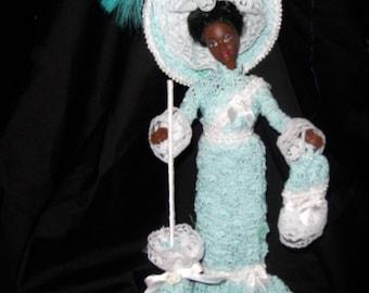 1910 Crocheted Dress in Aquamarine being display on Black Doll