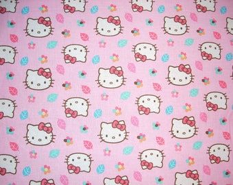 Hello Kitty on pink -  Cotton Fabric - 14 1/2inches wide and sold by the yard
