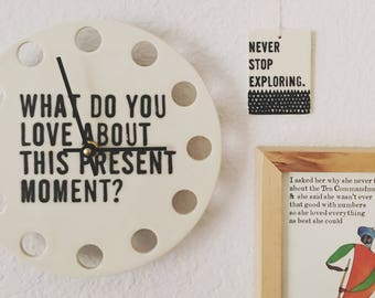 "porcelain clock 8.5"" screenprinted text what do you love about this present moment."
