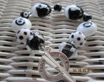 219  Black and white patterned handmade beaded bracelet