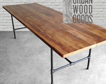 Reclaimed Dining Table with reclaimed wood top and iron pipe legs in choice of sizes or finishes