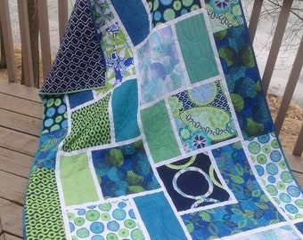 Blue Lagoon 50x71 quilt in blues, greens and minky