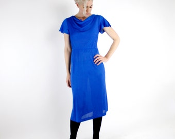 Vintage 70's sexy slinky disco dress, beautiful royal blue, fluttery sleeves, elastic waist, draped neckline, below knee, semi-sheer - Small