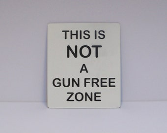 Sign, this is Not a gun free zone, 6 inches by 7 inches, custom color, laser engraved UV protected plastic