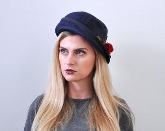 50's vintage hat. navy blue cloche. 1950 slouch hat. asymmetrical. rose flower.