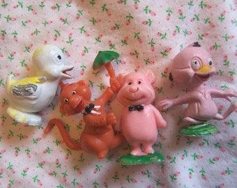 four little rubber plastic figurines