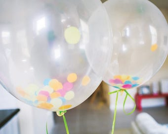 """6 clear Balloons (11"""") with one inch round paper confetti."""