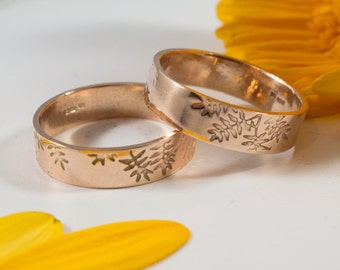 His and His Rose Gold Botanical Wedding Band: A pair of 5mm wide 9ct rose gold wedding band