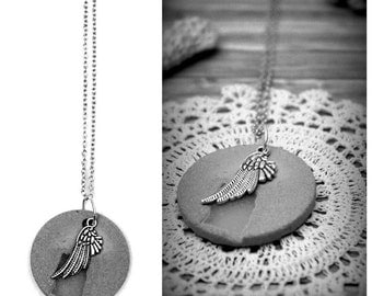 Concrete necklace with beach glas and metal wing